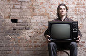 Man holding a retro television — Stock Photo