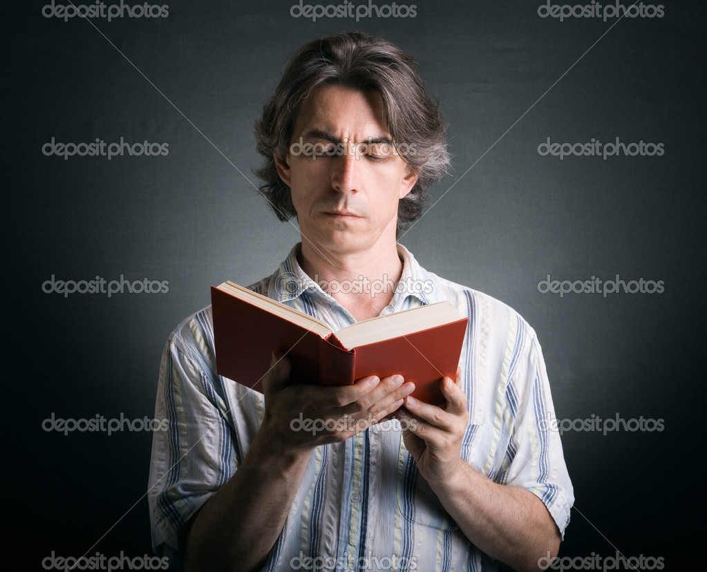 Cute man reading a book — Stock Photo #6233987
