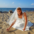 Stock Photo: Bride on sea shore