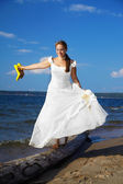 Bride with yellow shoes — Stock Photo