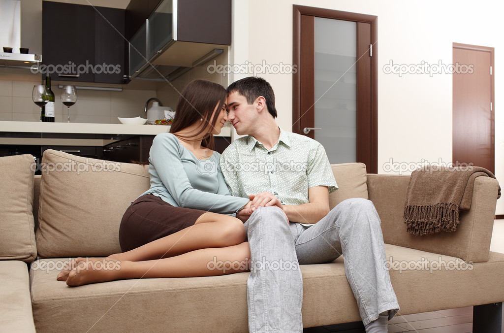 Happy newly married couple at home on sofa — Stock Photo #5485325