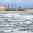 Ice drift and hydropower station - Stock Photo