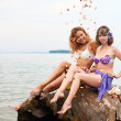 Girls on the log — Stock Photo