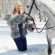 Beautiful girl with horse — Stock Photo #5674543