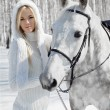 Beautiful girl with horse — Stock Photo #5674574