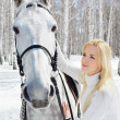 Beautiful girl with horse — Stock Photo #5674638