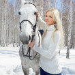Beautiful girl with horse — Stock Photo #5674682