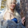 Girl in fur outdoors — Stock Photo #5674693