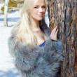 Girl in fur outdoors — Stock Photo