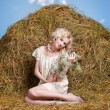 Country girl on hay — Stock Photo #5714045