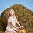 Stock Photo: Country girl on hay