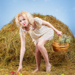 Country girl on hay — Stock Photo #5714495