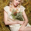 Country girl on hay — Stock Photo #5714537