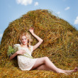 Country girl on hay — Stockfoto