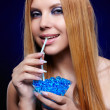 Stock Photo: Redhead girl with gel balls