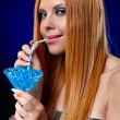 Royalty-Free Stock Photo: Redhead girl with fantasy drink