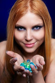 Redhead girl with gel balls — Stock Photo