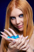 Redhead girl with gel balls — Stock Photo