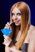 Beautiful redhead girl with gel balls — Stock Photo