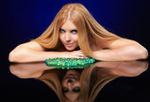 Beautiful redhead girl with gel balls — Stock Photo