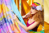 Woman artist painting — Stock Photo