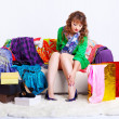 Shopaholic woman with purchases - Stock Photo