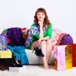 Stock Photo: Shopaholic womwith purchases