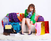 Shopaholic woman with purchases — Stock Photo