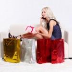 Blond girl on sofa — Stock Photo