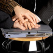 Foto Stock: Hands on laptop