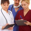 Doctors and nurse — Stock Photo #6734013