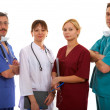 Three doctors and nurse - Stock Photo