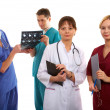 Three doctors and nurse — Stock Photo