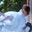 Stock Photo: Bride and fiance near window