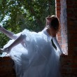 Bride near window — Stock Photo