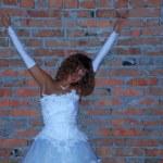 Bride near the wall — Stock Photo #6734373