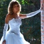 Bride near the wall — Stock Photo