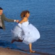 Running bride and fiance — Stock Photo