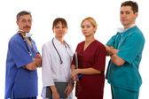 Three doctors and nurse — Stock Photo
