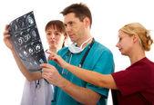 Doctors with tomogram — Stock Photo