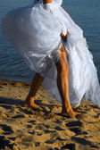Bride on the sand — Stock Photo