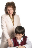 Schoolboy and teacher — Stock Photo