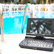 Laptop near pool - Stockfoto