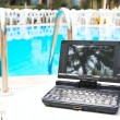 Laptop near pool - Lizenzfreies Foto