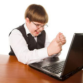 Boy with computer — Stock Photo