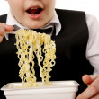 Boy eating instant noodles — Stock Photo