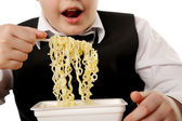 Boy eating instant noodles — Stockfoto