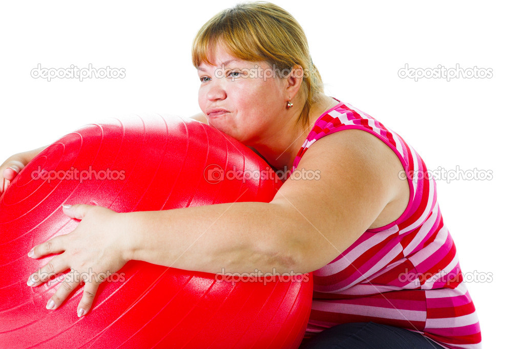 Tired fat woman with big red gymnastic ball — Stock Photo #6173570