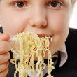 Stock Photo: Boy eating instant noodles