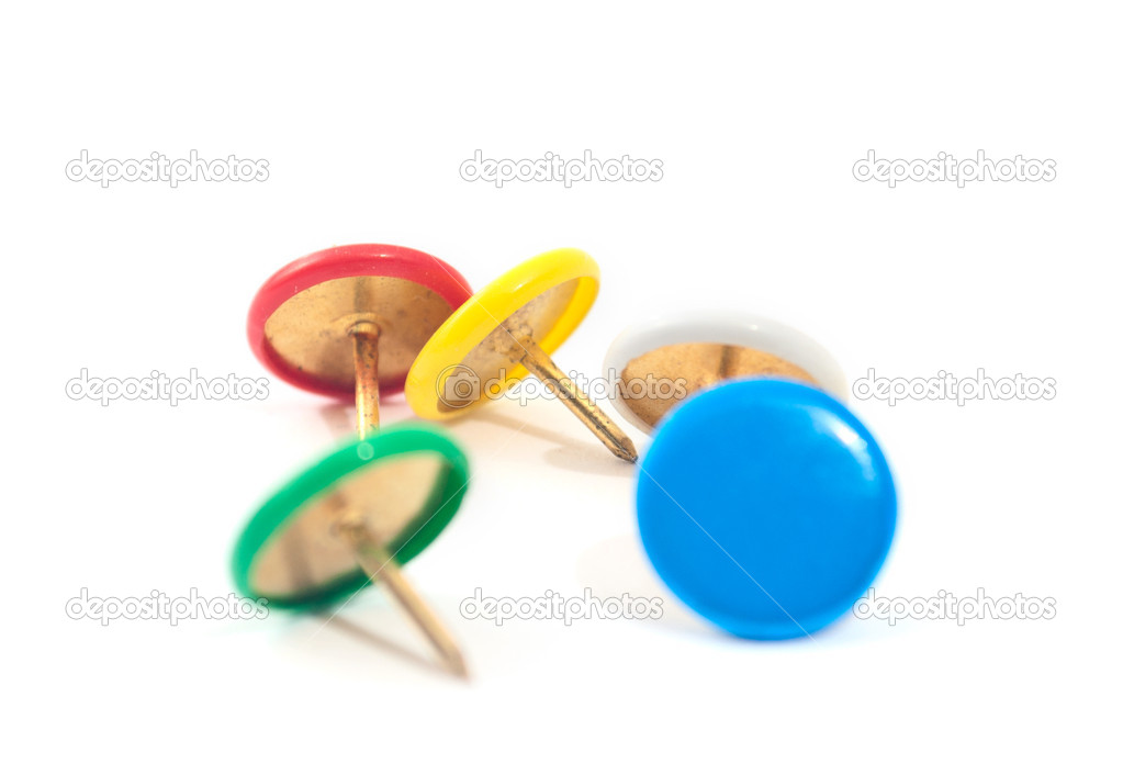 Colored drawing-pins on the white background — Stock Photo #5379500